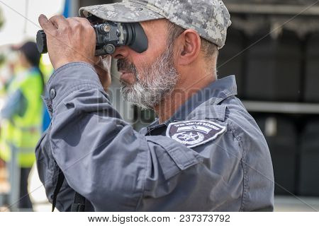 Beit Shemesh, Israel - April 19, 2018: The Man Of Israel Police Special Unit Looking Into Night Visi