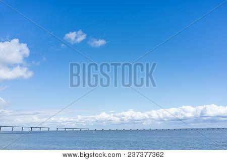 Long Bridge In Sea, Beautiful Summer Sky With Minimalistic Bridge, Background With Bridge, Summer Po