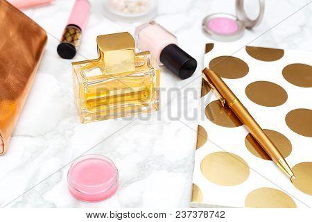 Perfume On The Working Feminine Desktop. Accessories