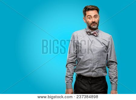 Middle age man, with beard and bow tie having skeptical and dissatisfied look expressing Distrust, skepticism and doubt