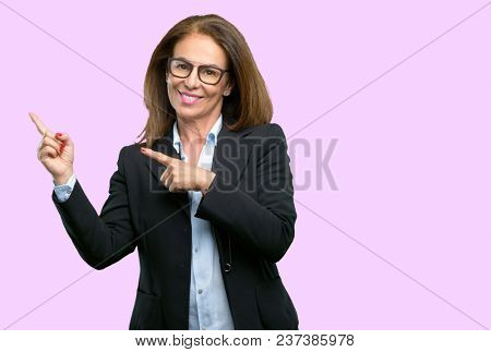 Middle age business woman pointing away side with finger