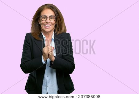 Middle age business woman confident and happy with a big natural smile