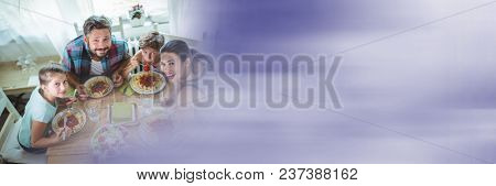 Overhead of family at table with blurry purple transition