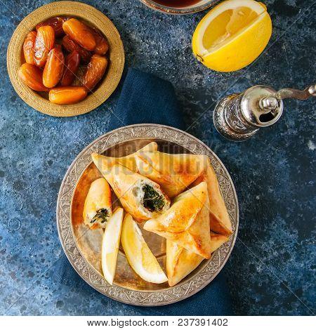 Iftar Food During Ramadan, Arabic And Middle Eastern Food Concept. Fatayer Sabanekh - Traditional Ar