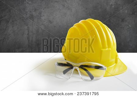 Background Yellow Safety Helmets And Goggles For Artisans On White Background And Empty Left Space F