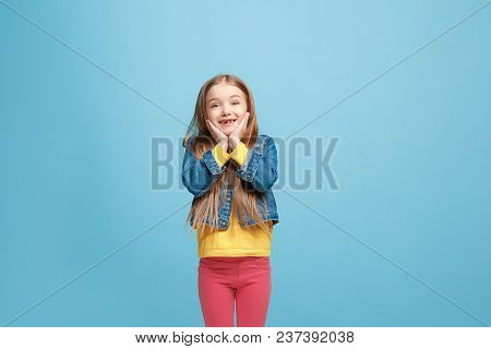 Wow. Beautiful Female Half-length Front Portrait Isolated On Blue Studio Backgroud. Young Emotional