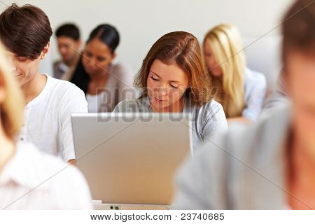 Female Student Working At Laptop