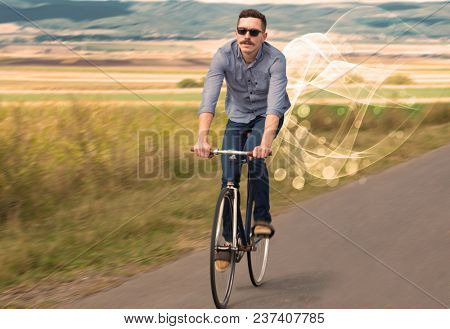 Gorgeous biker in the nature going somewhere with ethereal concept