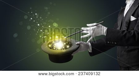 White glove hand conjuring something mysterious