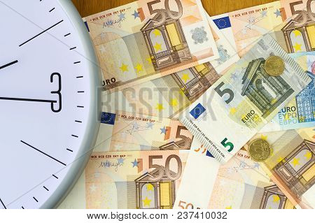 Clock And Banknotes Of Euro. Concept Time Is Money. View From Above. Business, Finance. Background.