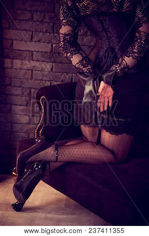 Beautiful Female Hands  Tied With Black Ribbon. Bound Girl In The Corset.