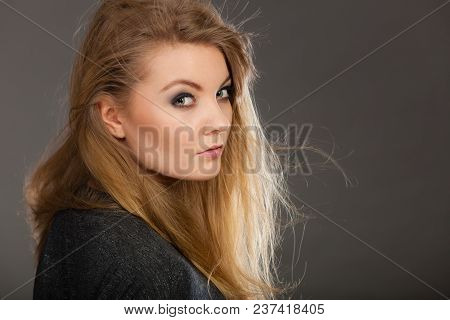 Haircare, Beauty, Hairstyling Concept. Portrait Of Young Attractive Blonde Woman Wearing Dark T Shir