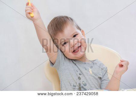 The Kid In The Kitchen Eats Milk Porridge
