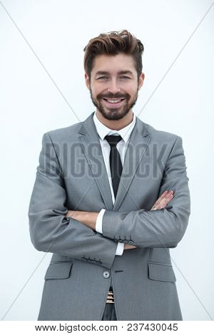 Confident bearded businessman standing with arms crossed