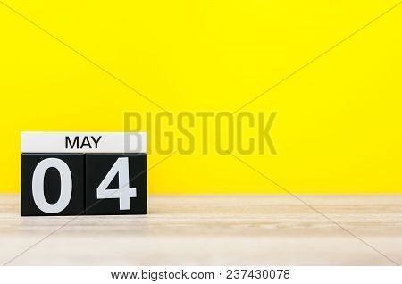 May 4th. Day 4 Of May Month, Calendar On Yellow Background. Spring Time, Empty Space For Text.