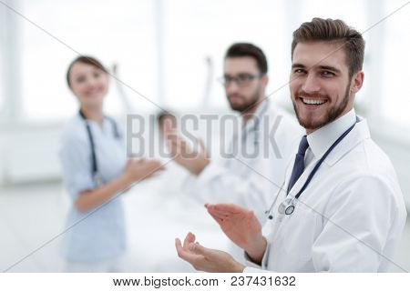Doctors clapping hands and applauding on consent