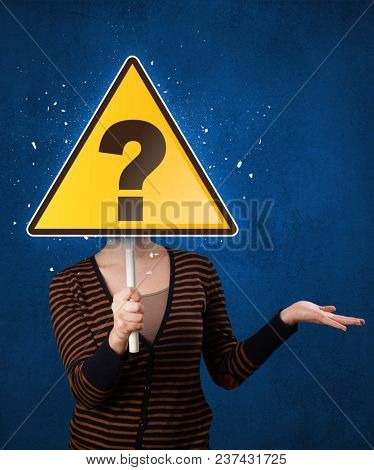 Casual young woman holding yellow sign with question mark