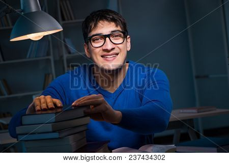 Student preparing for exams late at night in library