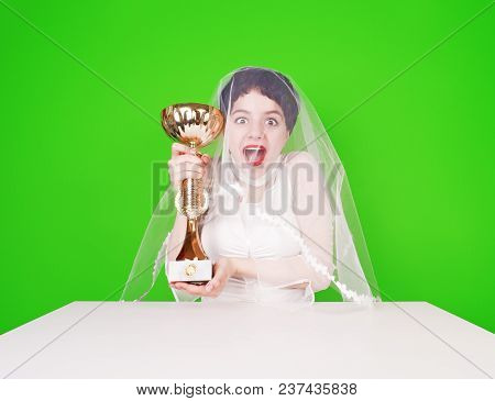 Caucasian Bride In A Wedding Attire Holding A Golden Trophy. Half Length Of Young Groom With A Troph