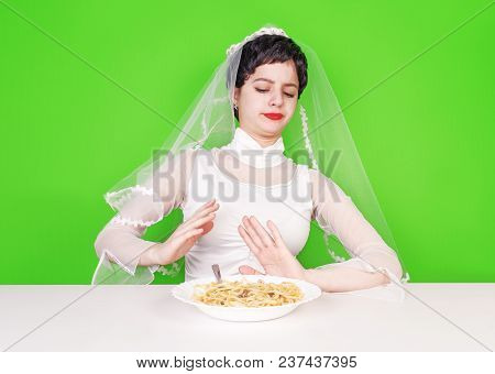 Stop The Flour. The Bride Shows By Hands The Refusal Of High-calorie Food For The Sake Of His Beauti