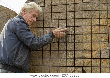 San Sperate, Italy, Sardinia - April 22, 2014: Italian Muralist And Sculptor Pinuccio Sciola In His