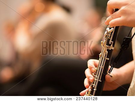 Oboe Player Performing In A Symphony Orchestra