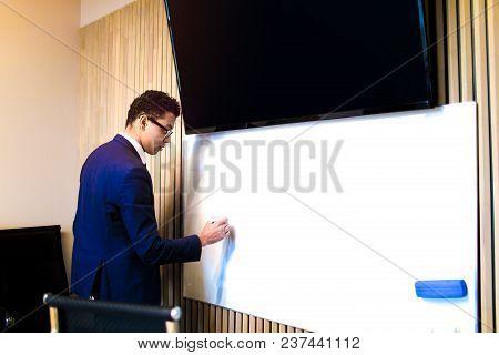 Business Man Writing Information On White Board With Copy Space For Promotional Content During Confe