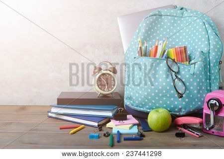 School Backpack And School Supplies On Wood Table