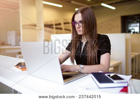 Female Clever Student Using Laptop Computer For Online Education, Sitting In University Library. Wom