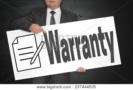 Warranty Poster Is Held By Businessman Picture