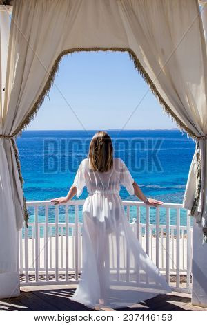 Luxurious Landscape At The Red Sea Beach Under The White Tent, With A Beautiful Caucasian Young Woma