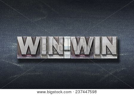 Win-win Word Made From Metallic Letterpress On Dark Jeans Background