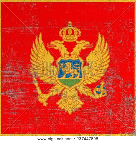 3d Rendering Of Montenegro Flag In A Scratched Surface