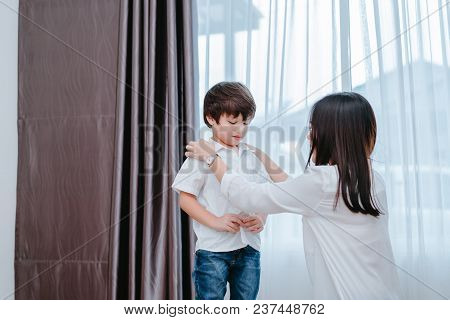 Mother Dressing Up A Son For Beginner School Lessen And First Day At Room To Going Kindergarten Educ