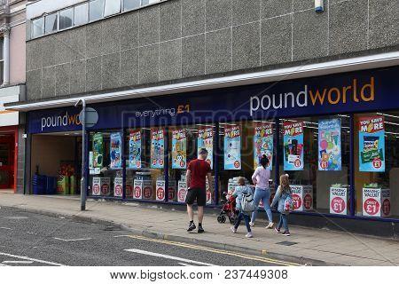 Barnsley, Uk - July 10, 2016: People Walk By Poundworld Discount Store In Barnsley, Uk. Poundworld H