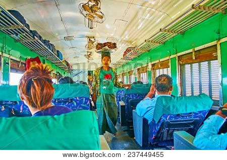 Yangon, Myanmar - February 16, 2018: The Food Vendor Walks Along The Second Class Wagon With Food Tr