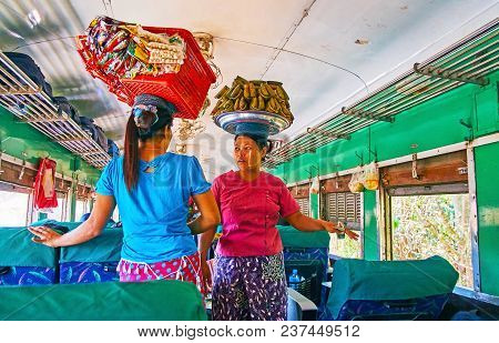 Yangon, Myanmar - February 16, 2018: Two Food Vendors With Food Basket And Tray On Their Heads Talk