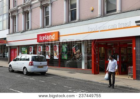 Barnsley, Uk - July 10, 2016: Man Exits Iceland Store In Barnsley, Uk. The Frozen Foods Company Icel