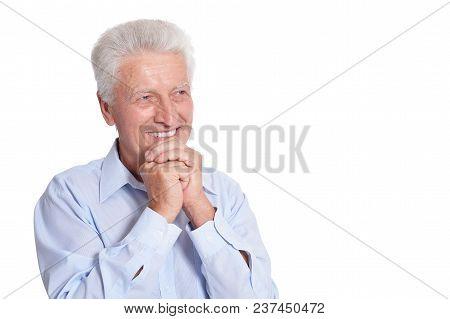 Smiling Senior Man In Blue Shirt Posing Isolated On White Background