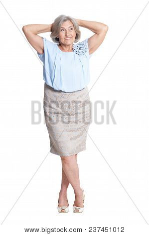 Portrait Of Senior Woman In Blue Blouse Posing Isolated On White Background