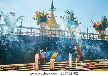 Thick Smoke Of Incense Sticks And Candles, Burning On The Altar Of Kyaiktiyo Pagoda On The Same Name