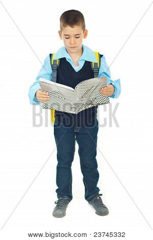 Full Length Of Schoolboy Reading