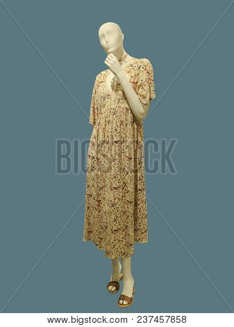 Full-length Female Mannequin Wearing Yellow Dress With Flower Pattern, Isolated. No Brand Names Or C