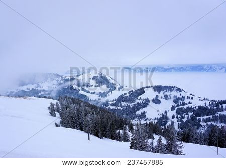 Snowy Mountains In The Alps Of Switzerland.
