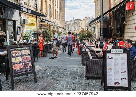 Bucharest, Romania - September 9, 2017: Old Town Street Cafe With People At The Smardan Street In Hi