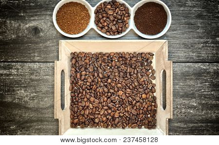 Caffeine Design Concept-ground Coffee, Instant Coffee And Coffee Beans On A Wooden Background.