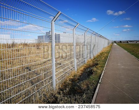 Steel Lattice Fence, Metal Wire Fence With Grass In The Background
