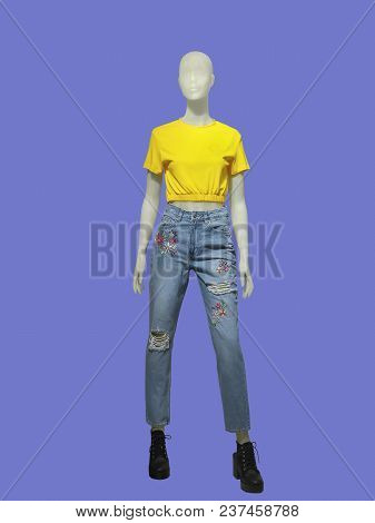 Full-length Female Mannequin Dressed In Blue Jeans And Yellow T-shirt, Isolated. No Brand Names Or C