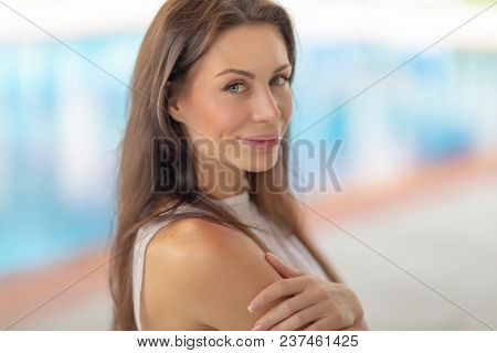 Closeup authentic portrait of a beautiful brunette woman outdoors, genuine beauty of a female with natural makeup, happy healthy lifestyle