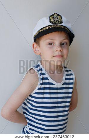 Portrait Of Little Cute Caucasian Boy In Captain's Hat